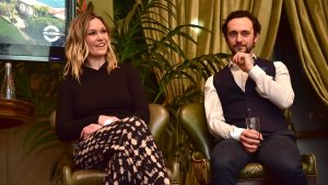 Eyes off the King! Julia Stiles and George Blagden share a moment.